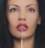 Femme avec la seringue Photographie stock libre de droits