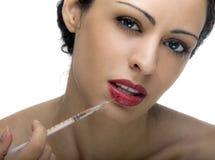 Femme avec la seringue Photo stock