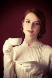 Femme avec la tasse de thé Images libres de droits