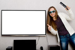 Femme avec la TV Photo libre de droits