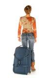 Femme avec la valise partant Photographie stock