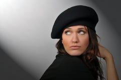 Femme avec le béret Photo stock