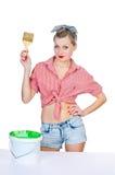 Femme avec le balai et la peinture Photo libre de droits