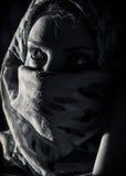 Femme avec le burka Photo stock