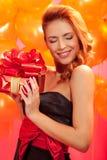 Femme avec le cadeau Images stock