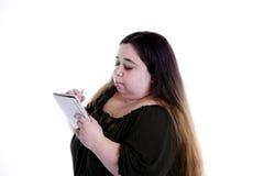 Femme avec le cahier image libre de droits