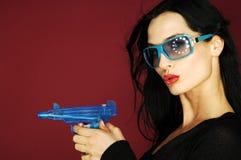 Femme avec le canon photos stock