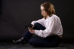 Femme avec le canon Photographie stock libre de droits
