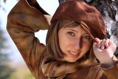 Femme avec le capuchon Photo stock