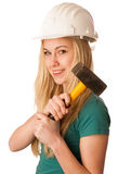 Femme avec le casque de constructeur et marteau heureux d'effectuer le travail dur Photographie stock