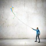 Femme avec le cerf-volant Photographie stock libre de droits