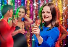 Femme avec le champagne à la partie Image stock