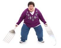 Femme avec le chemin de découpage géant de fourchette et de couteau Photographie stock libre de droits