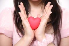 Femme avec le coeur Photos stock
