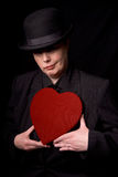 Femme avec le coeur de sucrerie Photographie stock libre de droits