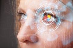 Femme avec le concept de panneau d'oeil de technologie de cyber photo libre de droits