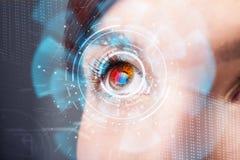 Femme avec le concept de panneau d'oeil de technologie de cyber Images stock