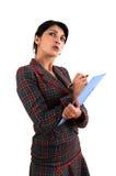 Femme avec le copyholder Photo stock