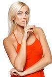 Femme avec le doigt sur des languettes photographie stock