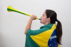 Femme avec le drapeau à l'arrière-plan blanc Image stock
