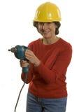 Femme avec le foret électrique Photos libres de droits