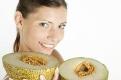 Femme avec le galia de melon Photo libre de droits