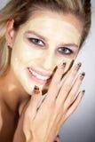Femme avec le grands maquillage et masque protecteur Photographie stock