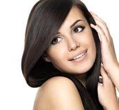 Femme avec le long cheveu droit de beauté Photographie stock