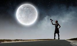 Femme avec le mégaphone Photographie stock libre de droits