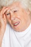 Femme avec le mal de tête Image stock