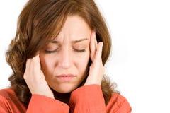 Femme avec le mal de tête images stock