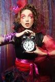Femme avec le maquillage créatif dans le style de poupée avec la montre Photo libre de droits