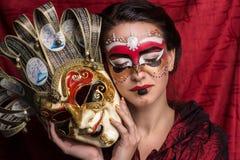 Femme avec le masque Photographie stock