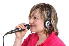 Femme avec le microphone Photo stock