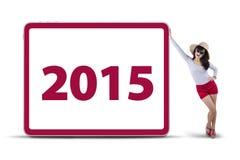 Femme avec le numéro 2015 à bord Photos libres de droits