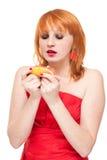 Femme avec le pamplemousse d'isolement Photographie stock libre de droits
