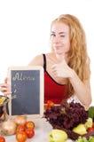 Femme avec le panneau de carte, légumes Photos libres de droits