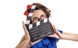 Femme avec le panneau de clapet de film d'isolement sur le blanc Photo libre de droits