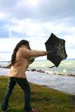 Femme avec le parapluie Photographie stock libre de droits