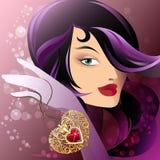 Femme avec le pendant de forme de coeur Images stock