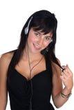 Femme avec le plan rapproché d'écouteur Photographie stock