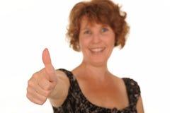 Femme avec le pouce vers le haut Photo stock
