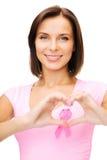 Femme avec le ruban rose de cancer Image stock