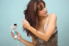 Femme avec le sèche-cheveux photo libre de droits