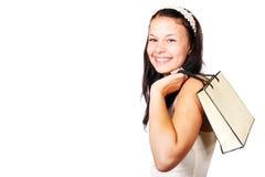 Femme avec le sac à provisions au-dessus de son épaule Photo stock
