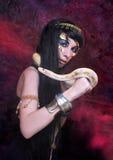 Femme avec le serpent. Image libre de droits