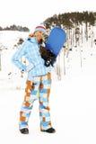 Femme avec le snowboard Image stock