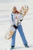 Femme avec le surf des neiges Photo libre de droits