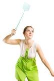 Femme avec le swatter de mouche Photo stock