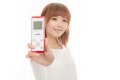 Femme avec le téléphone sans fil Image stock